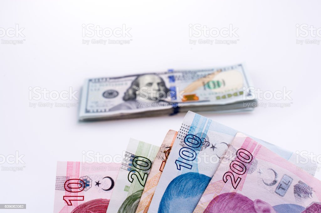 American dollar banknotes and Turksh Lira banknotes side by side stock photo