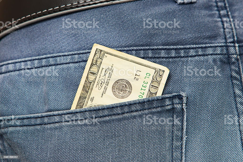 American dollar bills in jeans pocket background stock photo