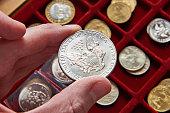 American dollar in hand of numismatist