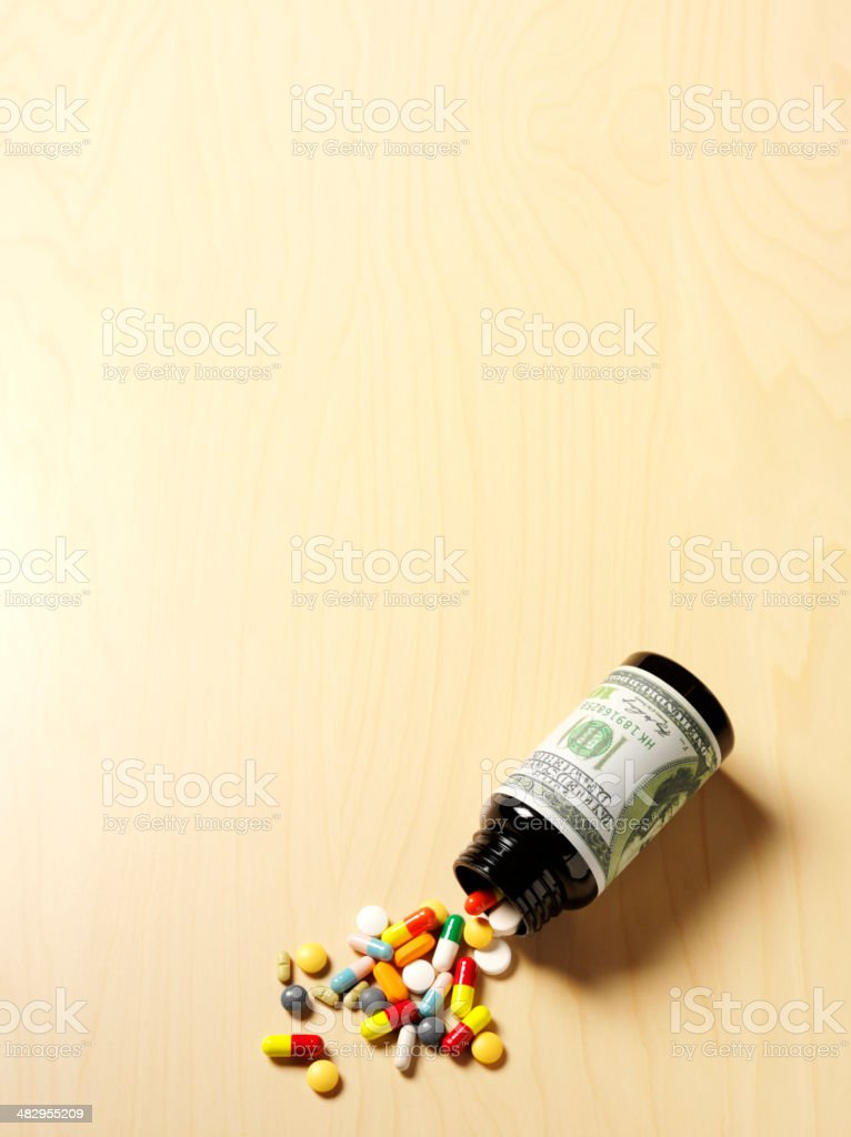 American Dollar Note with Medical Pills and Tablets stock photo