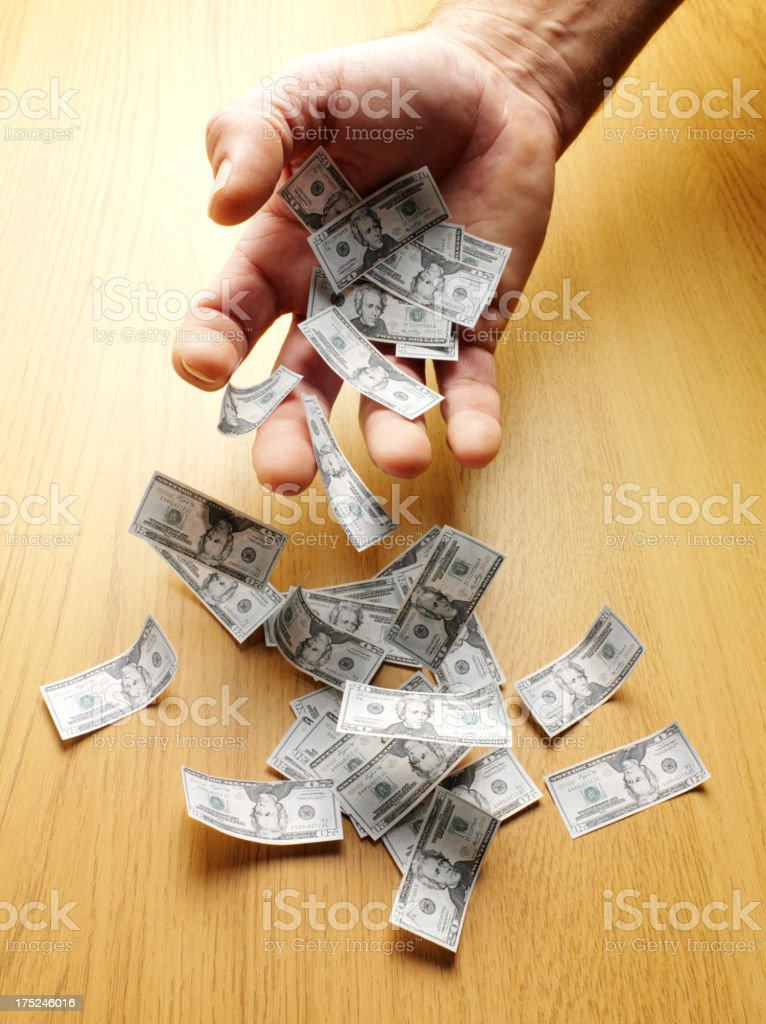 American Dollars Falling through the Palm of a Hand. royalty-free stock photo