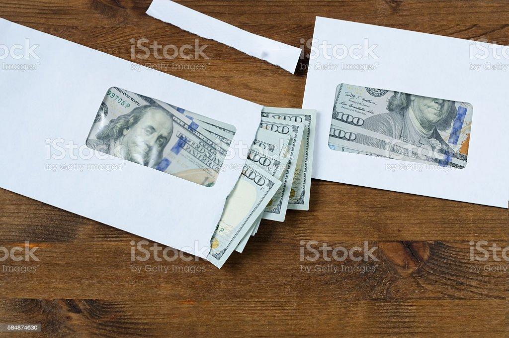 American dollars in envelopes stock photo