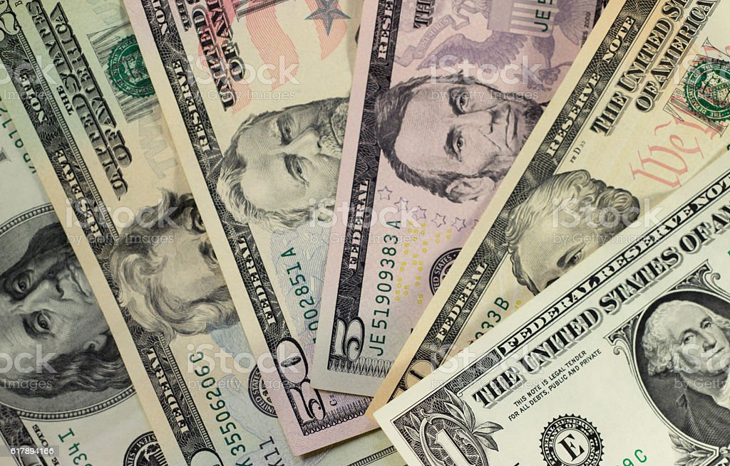 American dollars of different nominal fanned out top view stock photo