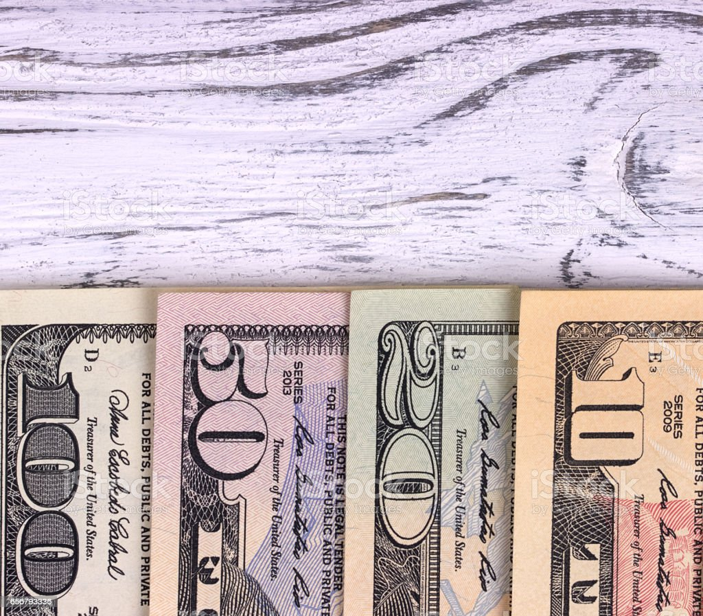 American dollars on old white wooden plank. stock photo
