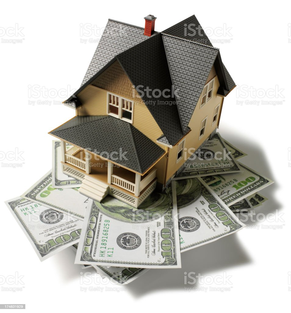 American Dollars Under a Toy Model House royalty-free stock photo
