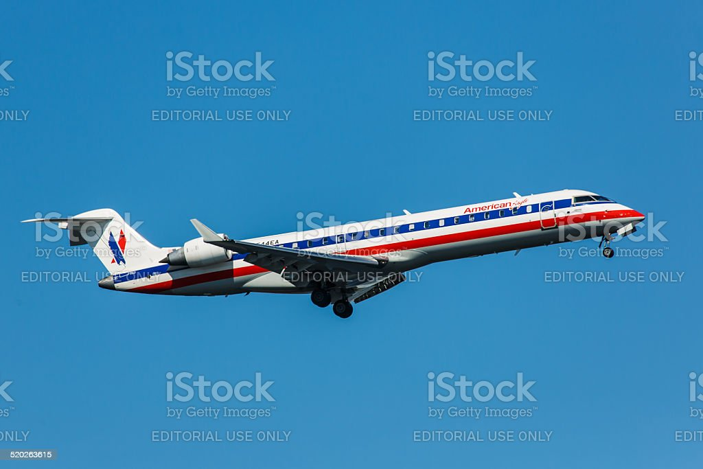 CRJ700 American Eagle Airlines takes off from JFK Airport stock photo