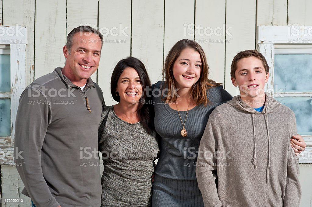 American family in yard with happy smiles Autumn by barn royalty-free stock photo