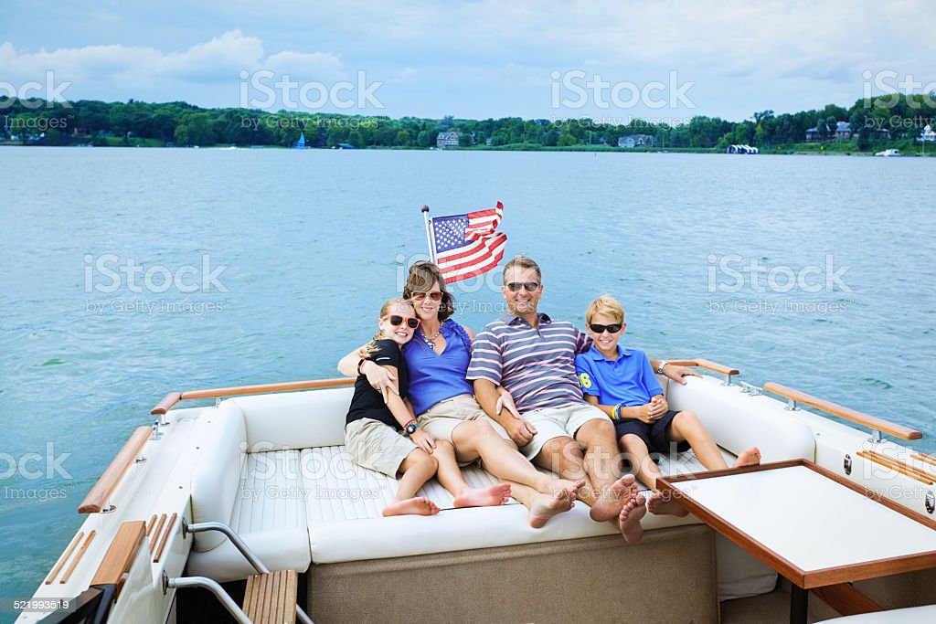 American Family Motorboating, Relaxing in Boat on Midwest USA Lake stock photo