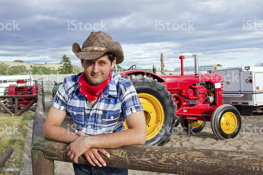 American farmer in cowboy hat standing near his tractor royalty-free stock photo