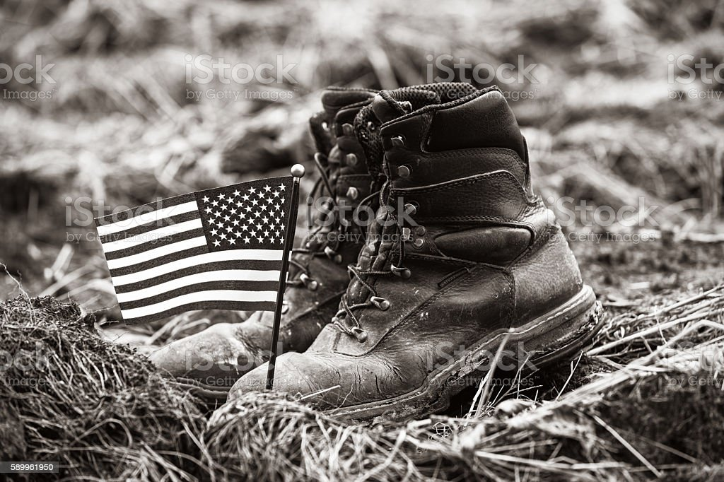 American Farmer's Old Leather Work Boots with Flag stock photo