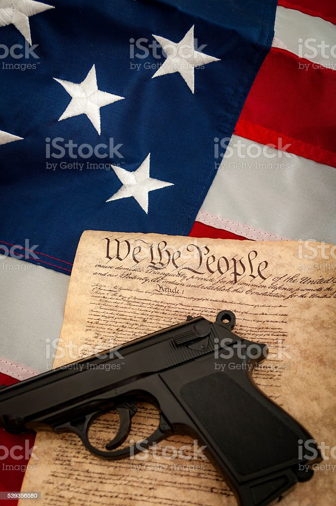 American flag, a gun and the US constitution stock photo