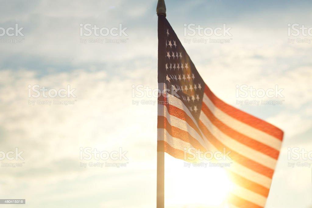 American Flag Against Blue Sky stock photo