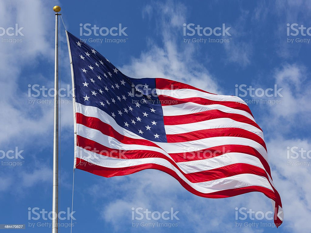 American flag against the sky stock photo