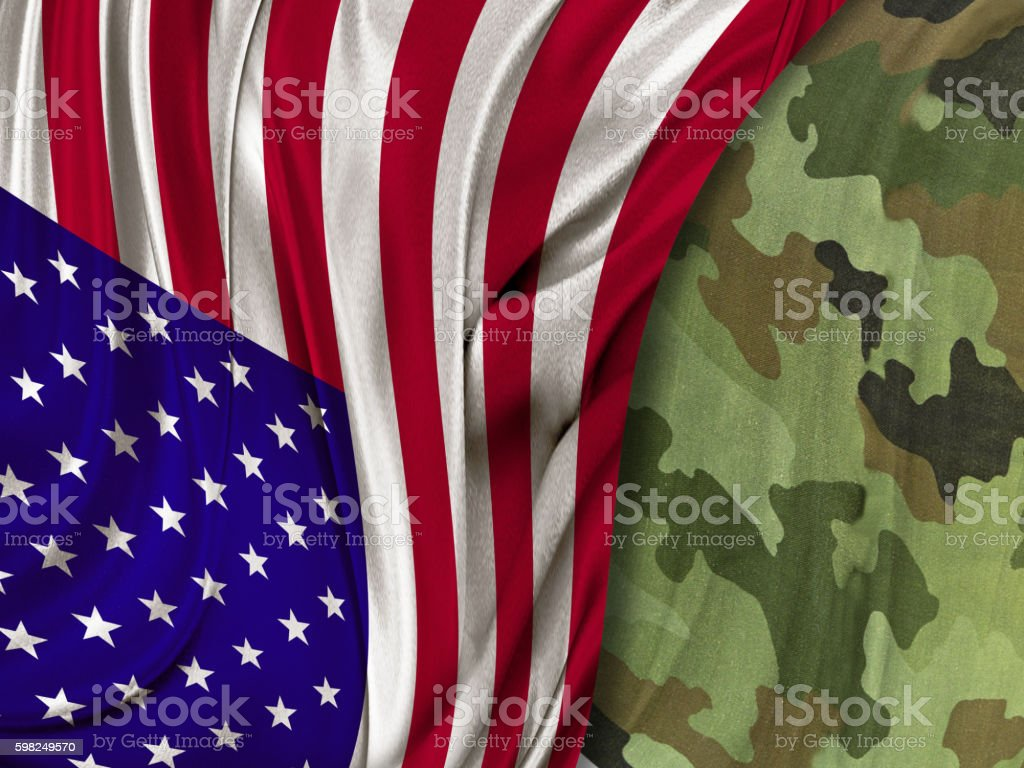 American flag and camouflage stock photo