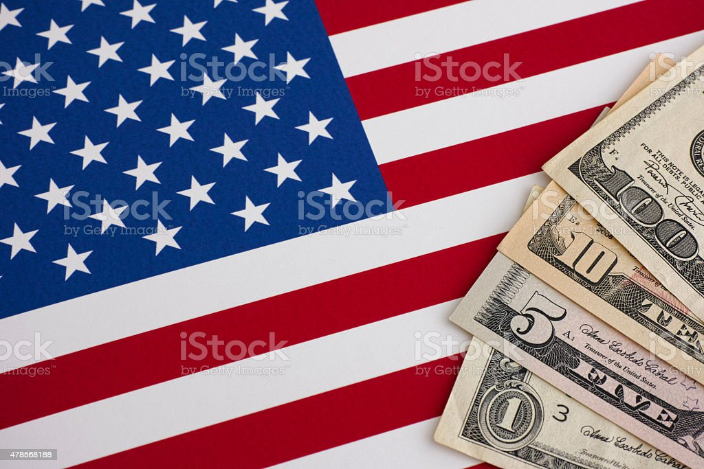 American flag and dollars stock photo