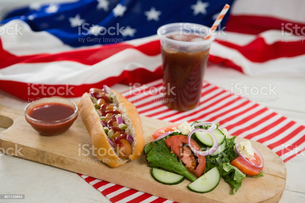 American flag and hot dog on wooden table stock photo