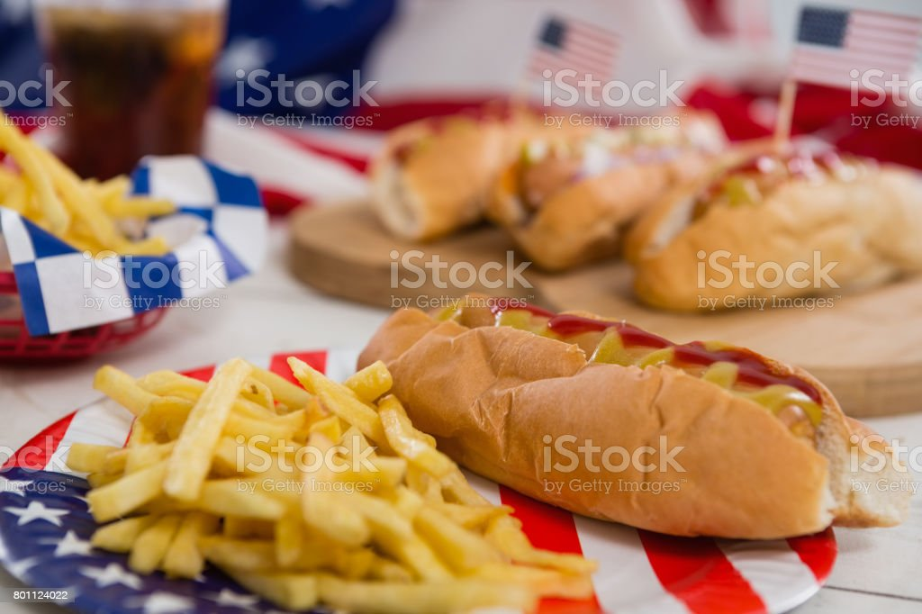 American flag and hot dogs on wooden table stock photo