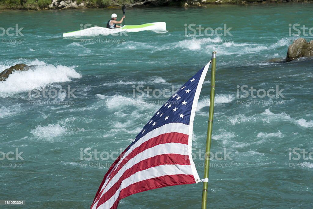 American Flag and Kayak on Soca River Slovenia Europe royalty-free stock photo