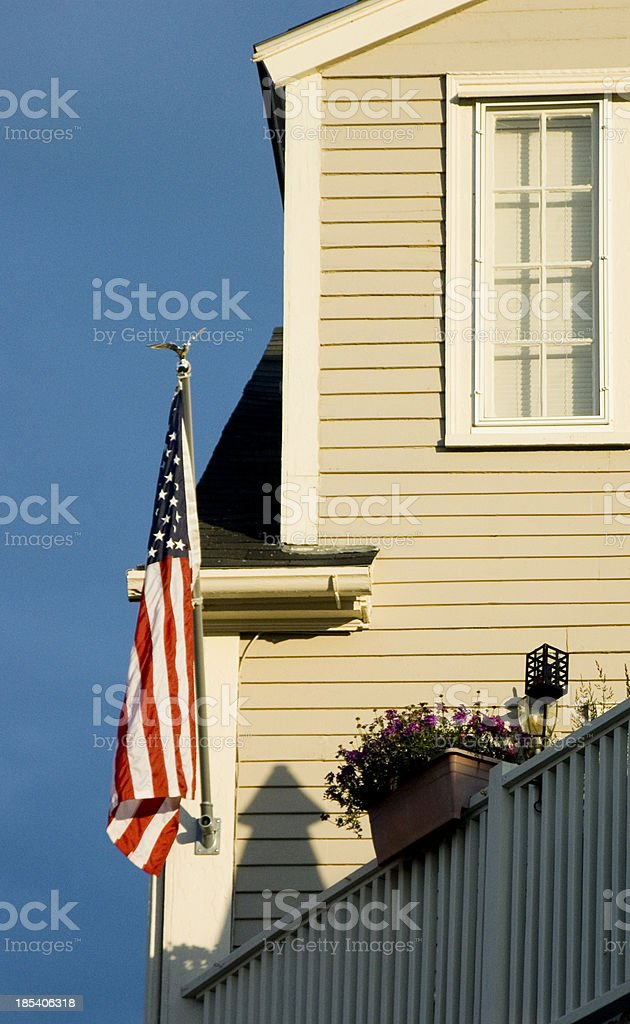 American flag and New England home stock photo