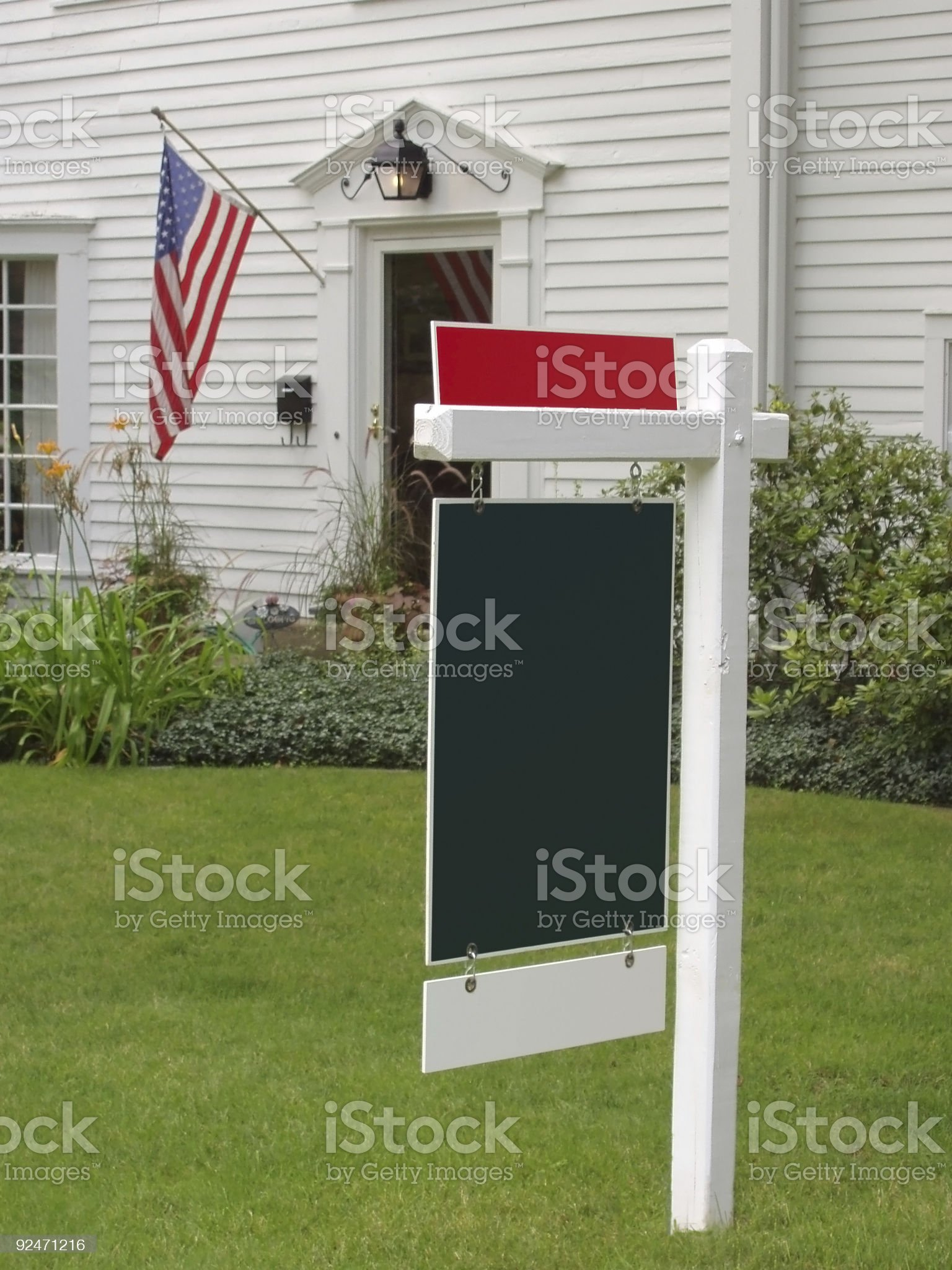 American Flag and Real Estate Sign royalty-free stock photo