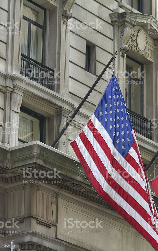 american flag at a building entrance- New York City stock photo