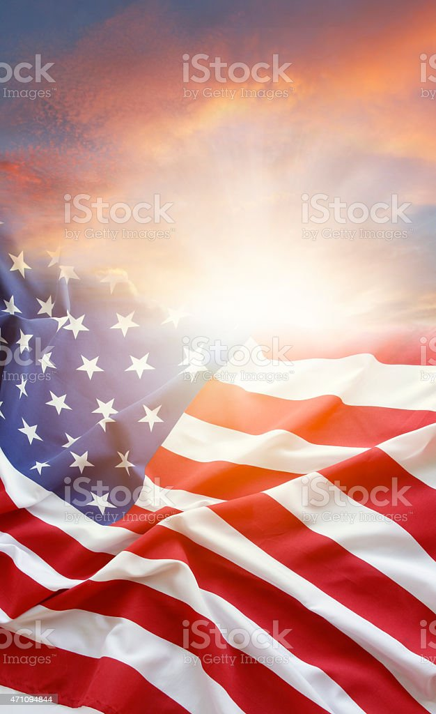 American flag at the wind with stock photo