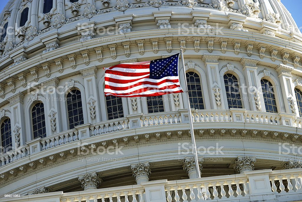 American flag at US Capitol Building stock photo