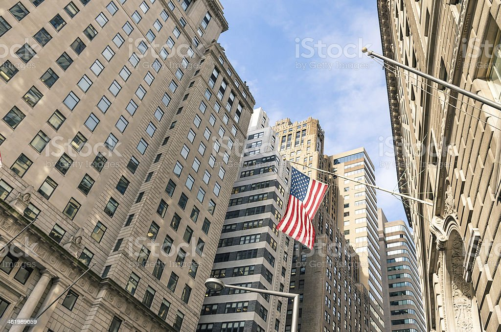 American Flag at Wall Street - New York financial District stock photo