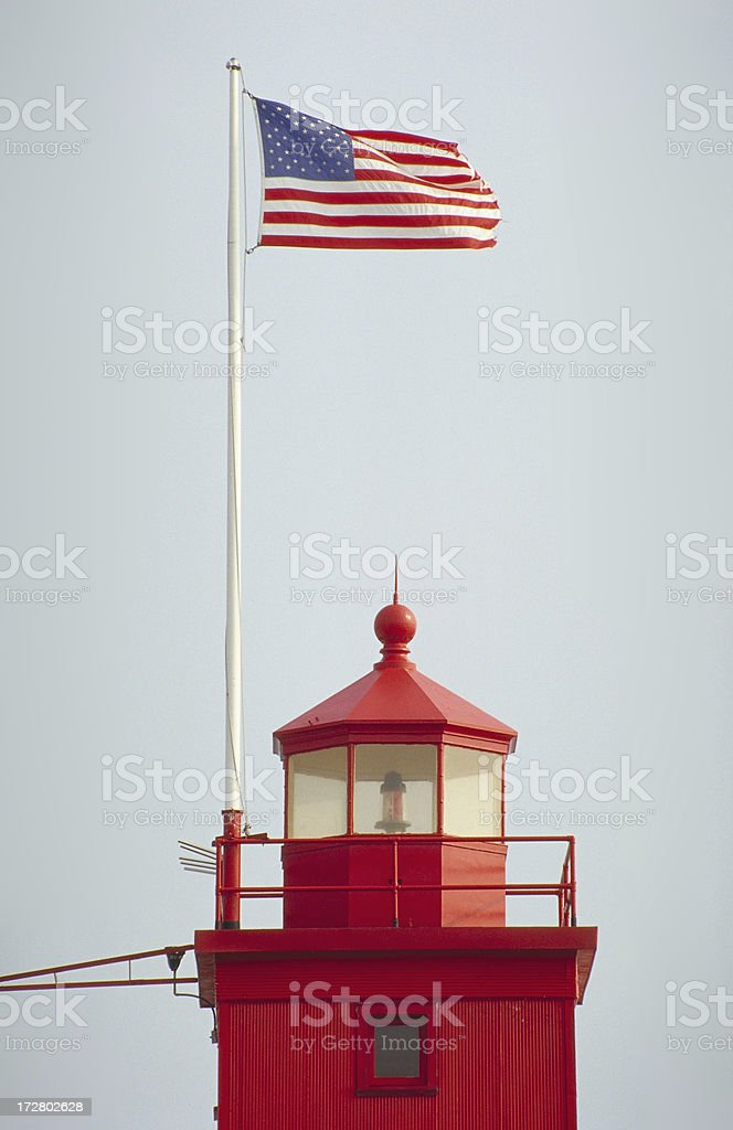 American flag atop Holland Lighthouse stock photo