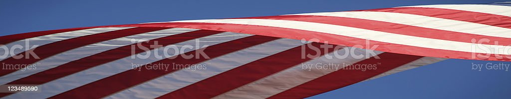 American Flag Blowing in the Wind royalty-free stock photo