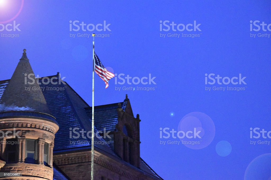 American Flag by old building stock photo