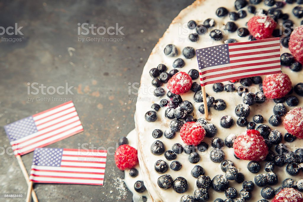 American flag cake with blueberry and raspberry stock photo
