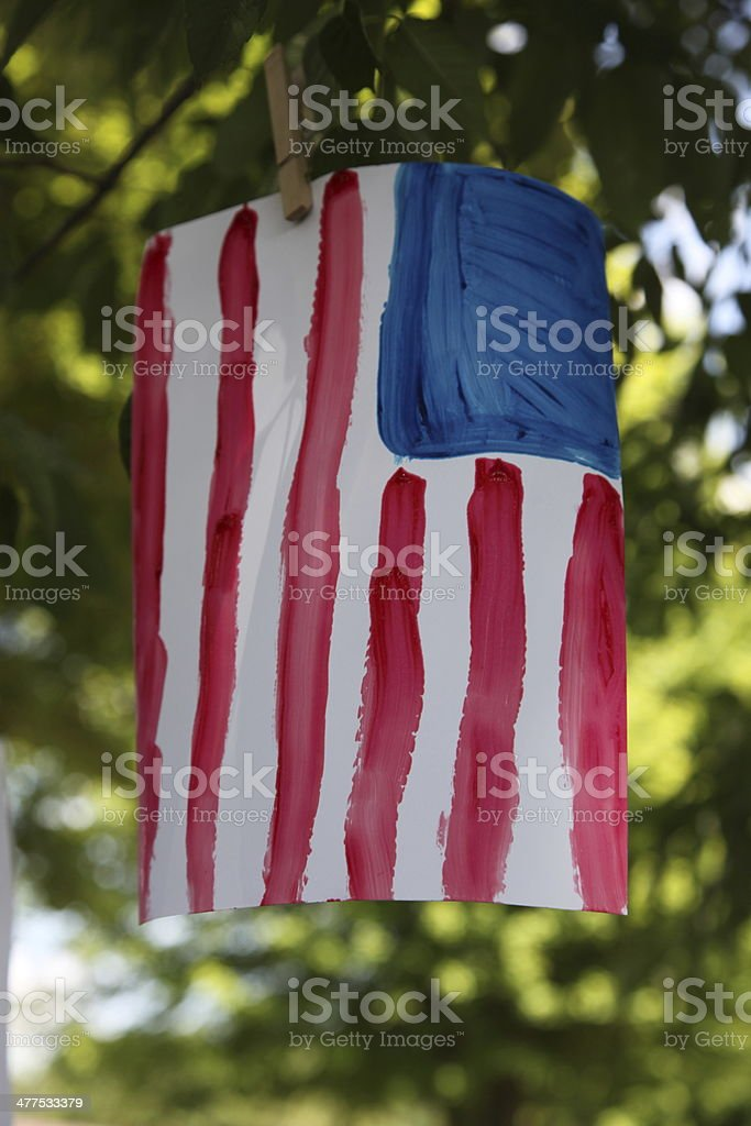 American Flag finger paint and hanging in tree royalty-free stock photo