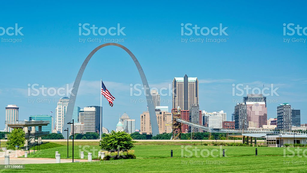 American flag flies over St. Louis with arch stock photo