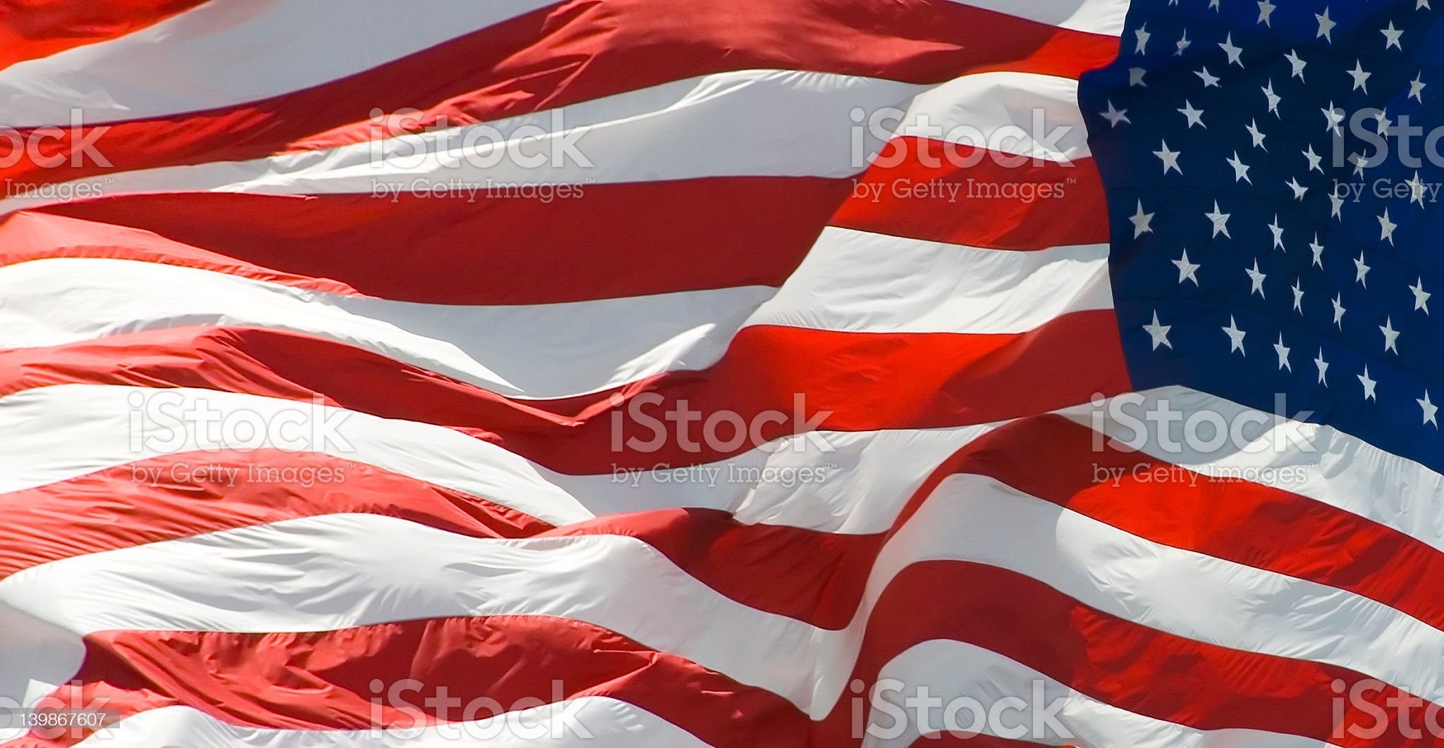 American flag flying in the wind royalty-free stock photo