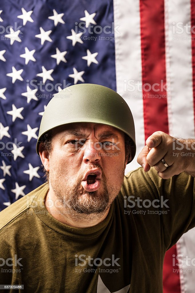 american  flag GI drill sergeant soldier points finger shouts stock photo