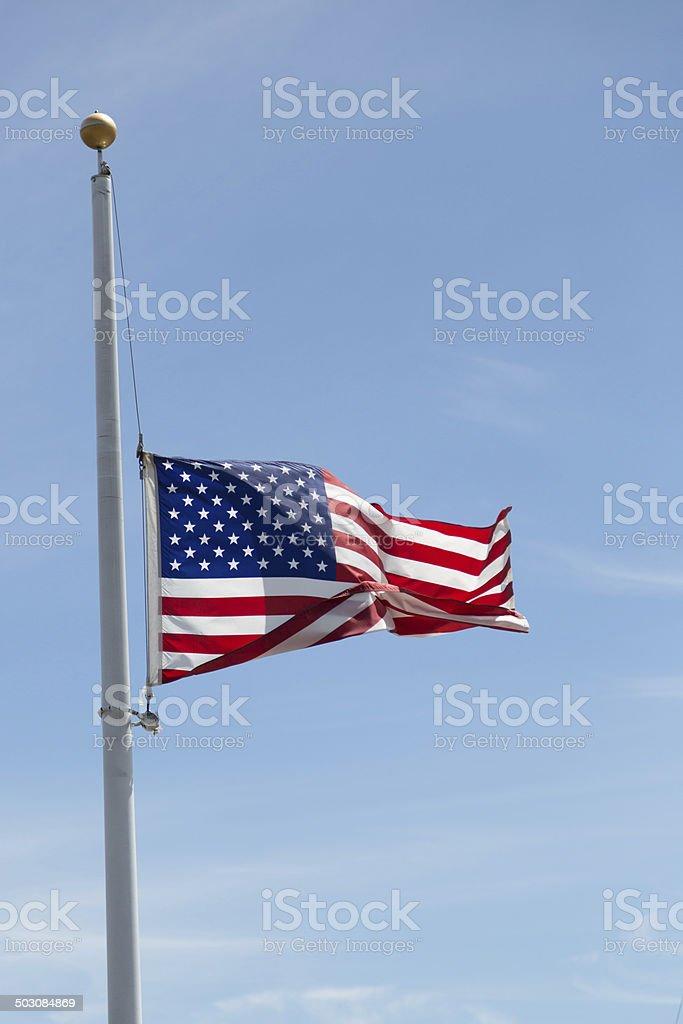 American Flag, Half-Mast against blue sky stock photo