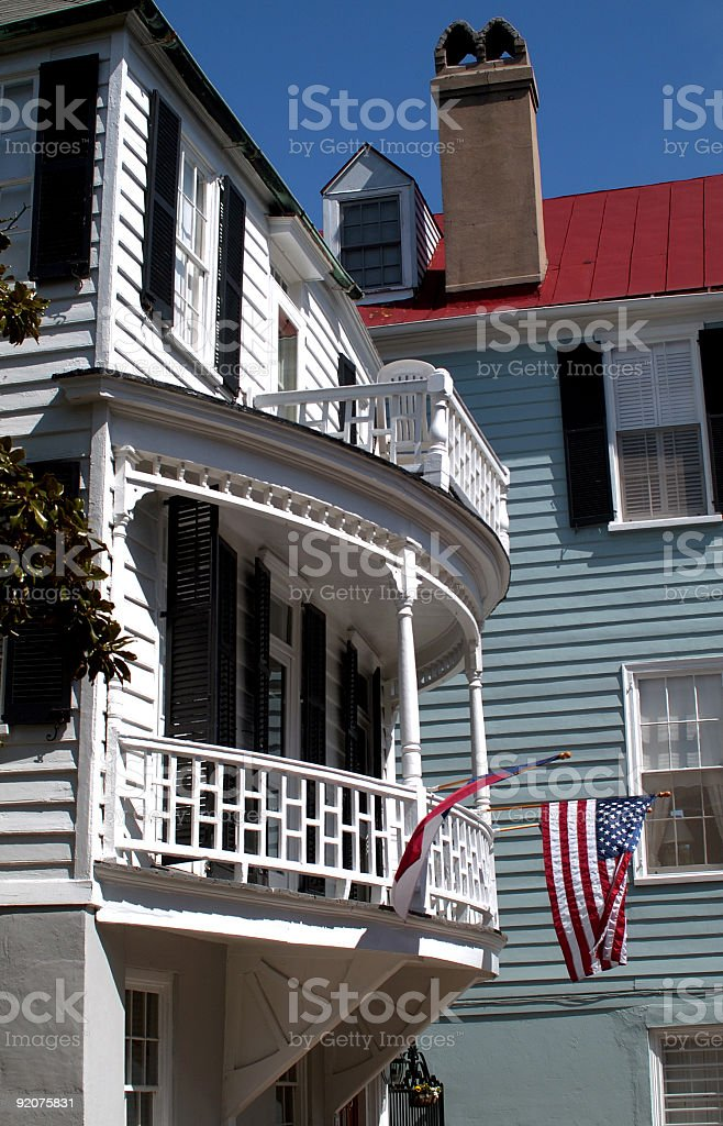 american flag hanging from old Southern home royalty-free stock photo