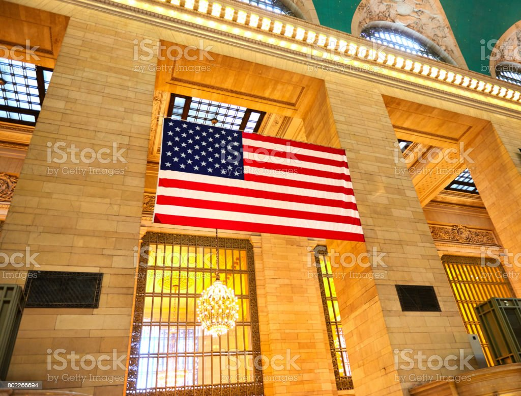 American flag hanging on Grand Central Station in New York City, Manhattan stock photo