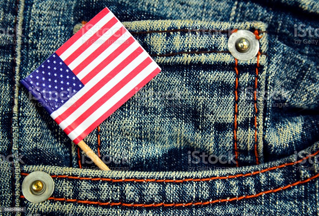 American flag in a pocket of blue jeans. stock photo