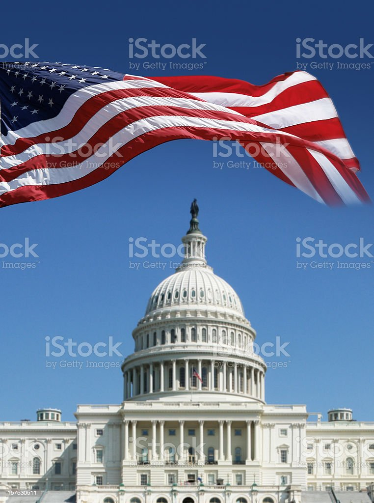 American Flag in front of The Capitol royalty-free stock photo