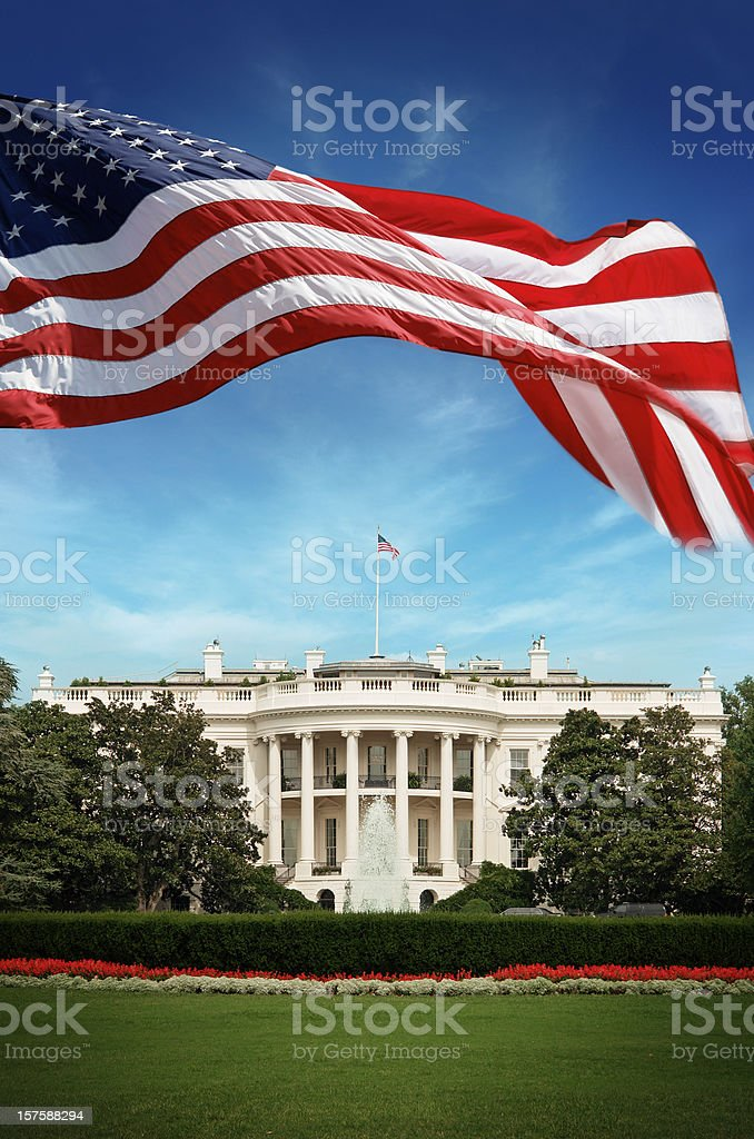 American Flag in front of The White House royalty-free stock photo