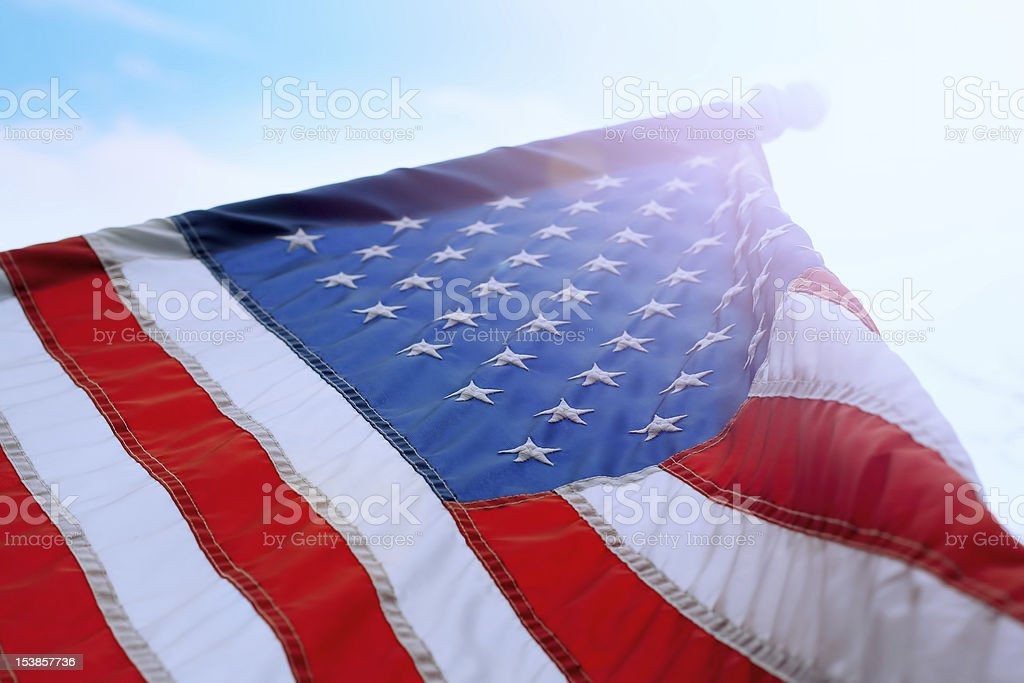 American Flag in sunny sky royalty-free stock photo