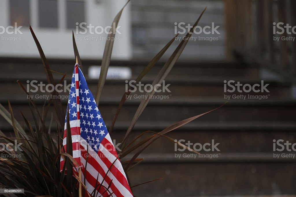 american flag in the front yard stock photo