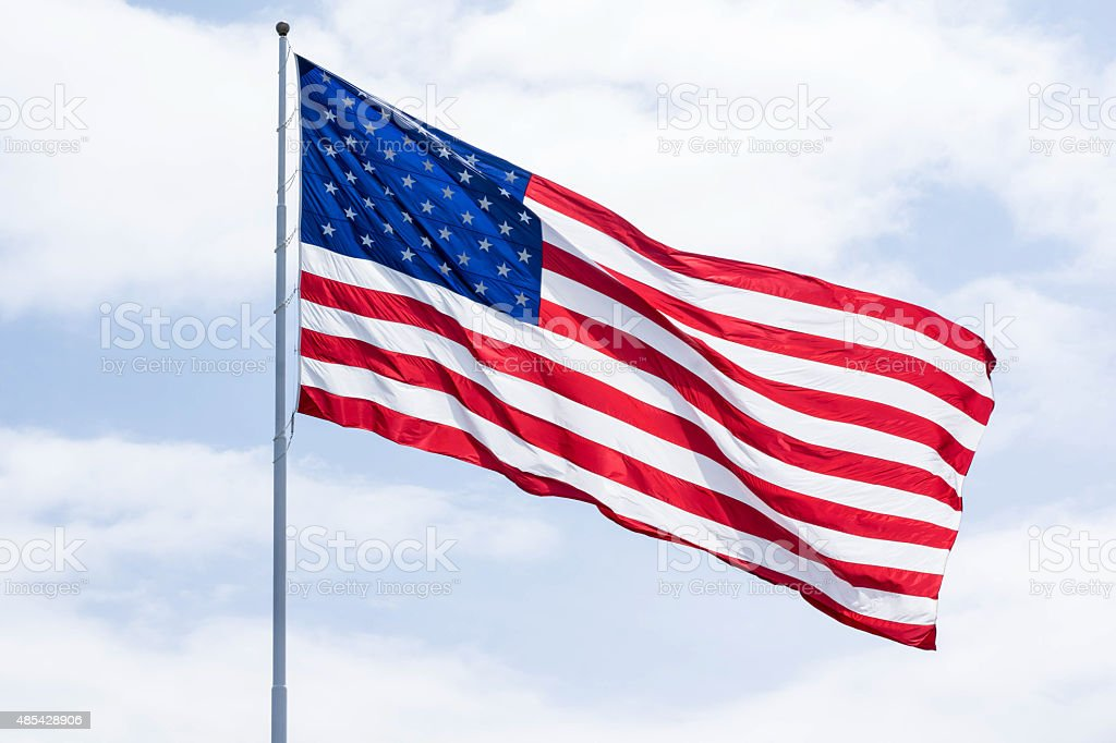 American flag in the wind stock photo