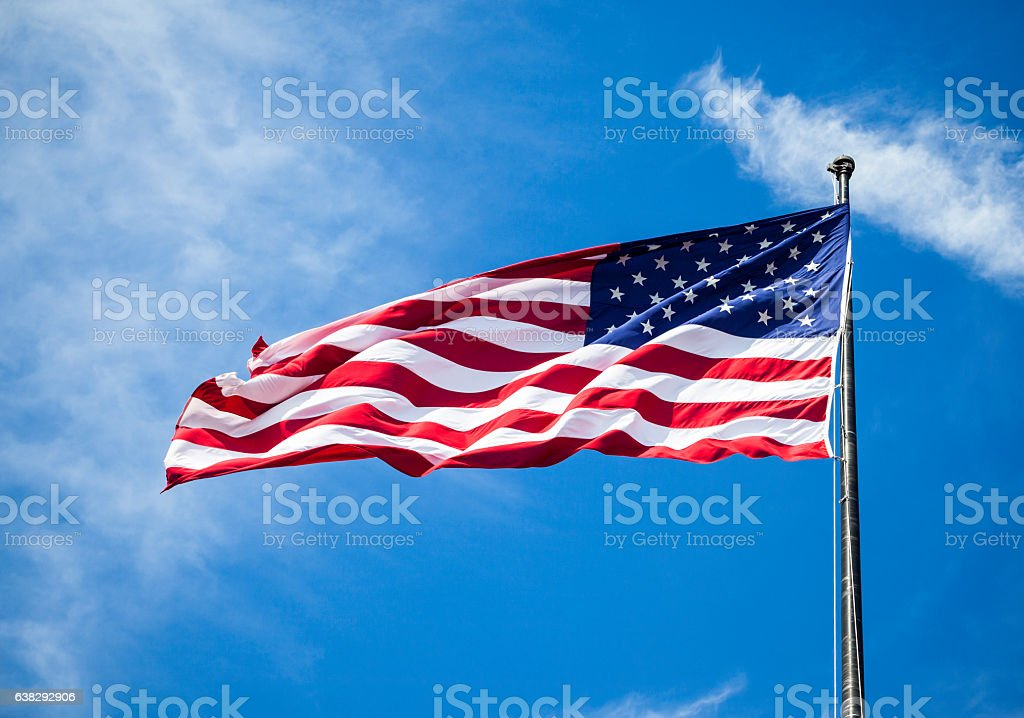 American flag on a flagpole stock photo