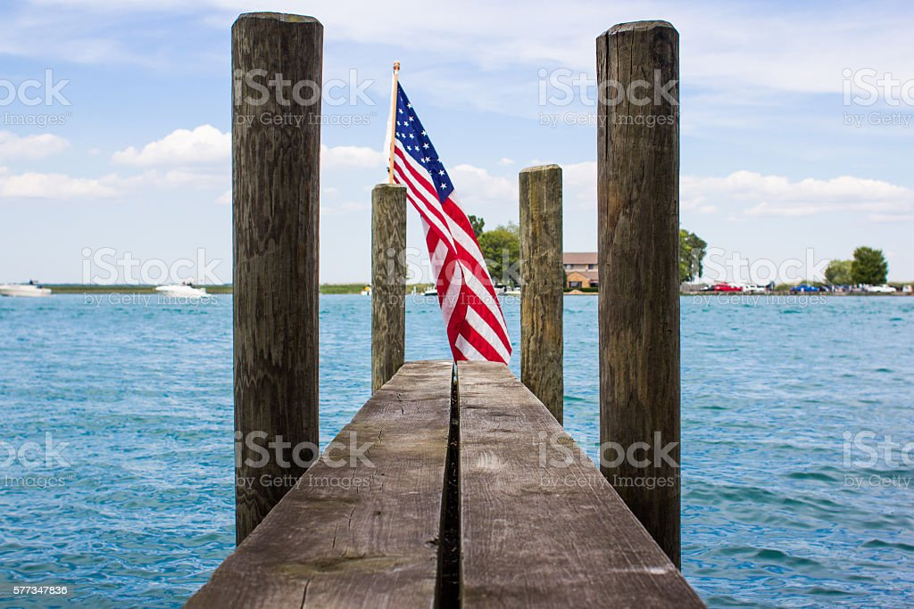 American flag on a hulk with blue sky and lake stock photo