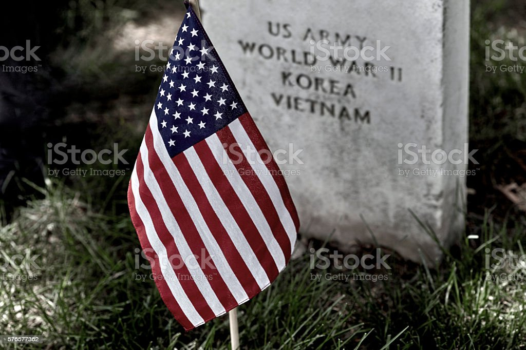 American Flag on a Soldiers Gravesite stock photo