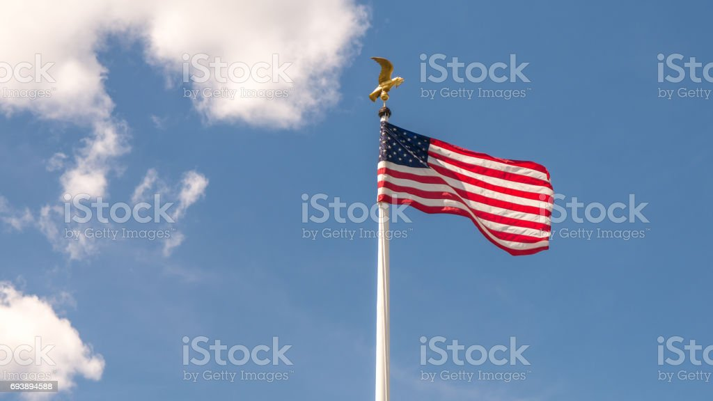 US American flag on a sunny day stock photo