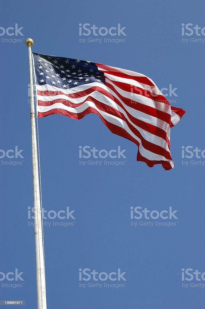 American Flag on blue sky stock photo